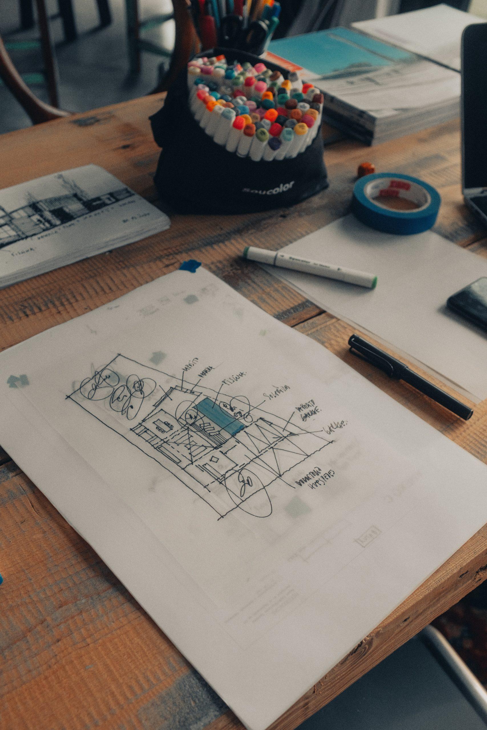white printer paper beside pen and pen